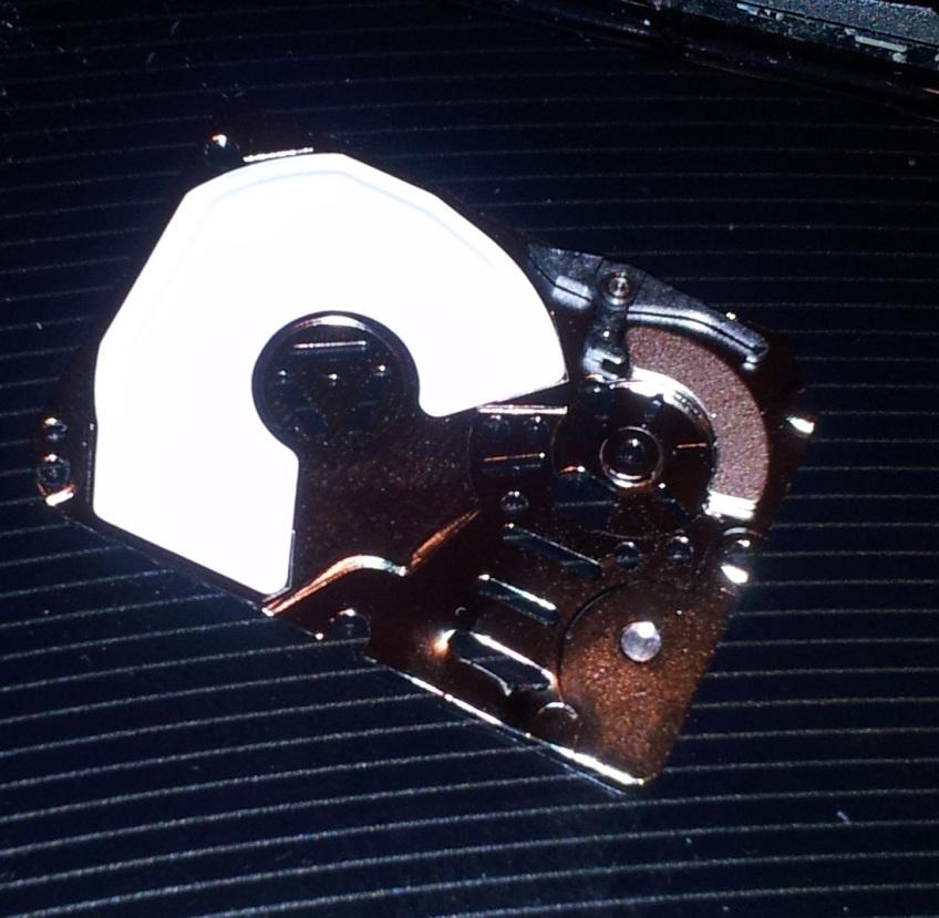 Hard disk magnet on backing